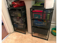 Two black cupboards for storage