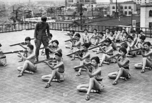 WWII photo Japanese girls rehearse a dance number on the roof of a house in O@44