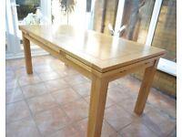 Beautiful solid oak 6 foot extending dining table.