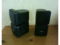 Pair of small Reflex surround sound speakers.