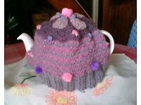 NEW HAND KNITTED TEA COSY - LILACS, PINKS, & PURPLES - FLOWERS & POMS