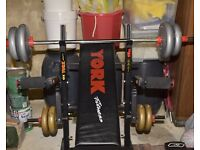 weights including dumbbell, barbell and a york bench in good condition