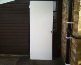 Plain hardboard faced interior door.Good condition.Fitted lock and hinges.