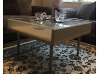 Coffee table Cream and gray in base and glass on top