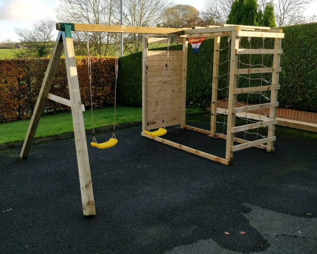 Wooden climbing frame and swing set