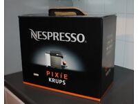 Nespresso PIXIE coffee machine brand new and 100 capsules included