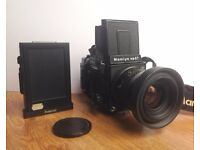 Mamiya RB67 with 90mm f3.5 Lens, one film back and polaroid back.