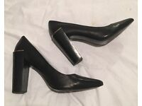 MUST SELL - black leather heels with gold metal detail