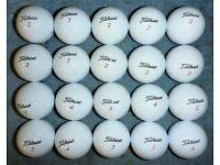 20 New Titleist golf balls in mesh ball bag