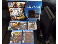 PS4 WITH 1 CONTROLLER AND 5 GAMES IN THE ORIGINAL BOX WITH COOLER/CHARGING STAND