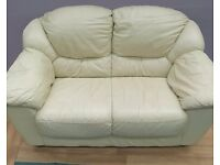 Cream two seater leather sofa (Local delivery available £5-£10)
