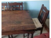Soild table and six chairs cast iron backs