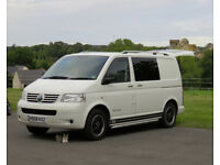 VW T5 camper day van with awning and extras.