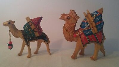 Pair if hand carved and painted wood camels