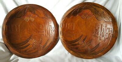 PAIR OF ORNATE CARVED WOODEN WALL CHARGER PLATES