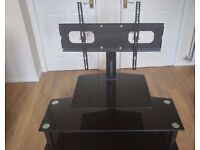 Black Glass TV stand with cantilever TV mounting brackets