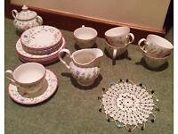 Set of 6 cups, saucers, side plates, cream jug, milk jug and milk jug cover. Johnston Brothers.