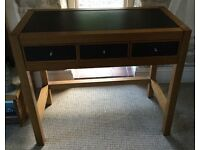 Wooden side board with 3 leatherette fronted drawers and top