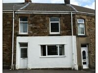 Large 3-bedroom, recently decorated family home in Morriston, close to shops and Primary School.