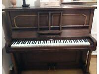 Piano - FREE. Good working order, the backing material needs repairing. Must be able to collect.