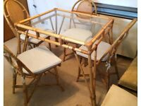 Cane & Glass Dining Table plus a Coffee Table with 4 Cane Chairs for sale