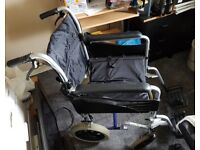 Folding wheelchair with brakes on handles