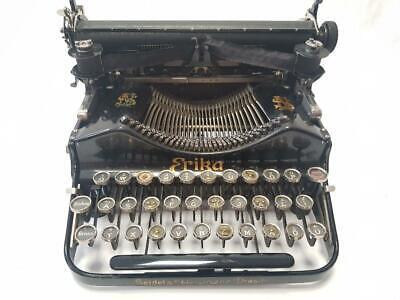 Antigua maquina de escribir plegable ERIKA folding rare typewriter 1919