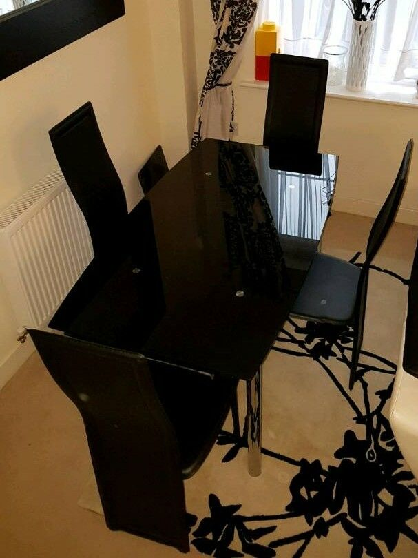 Black Glass Extending Dining Table with 4 high back chairs