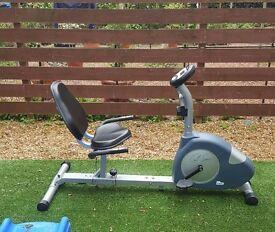 Carl Lewis recumbent exercise bike.