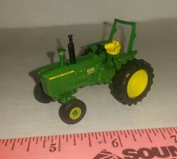 1/64 ERTL custom farm toy John deere model 4000 tractor with rops free shipping!