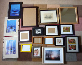 Assortment of picture frames some with pictures