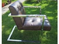 PAIR OF FAUX LEATHER AND CHROME ARMCHAIRS