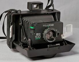 Vintage Polaroid EE100 Special instant camera and packs of film