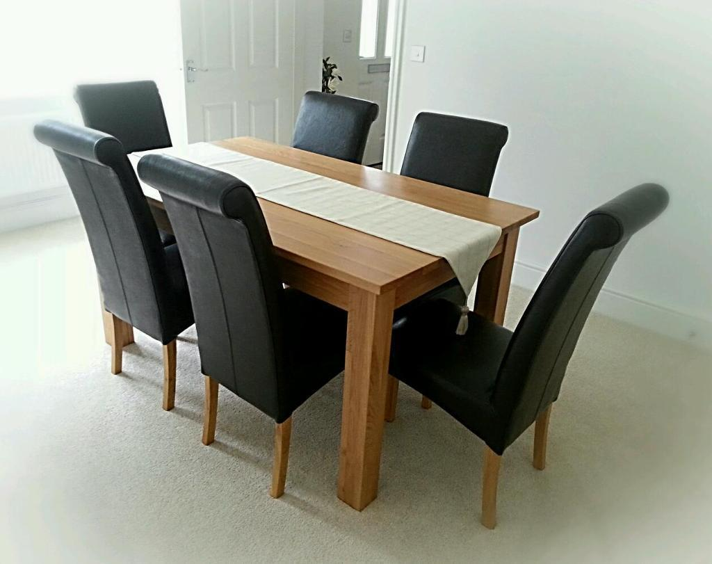 Solid Oak Dining Table And Six Real Leather Rollback Chairs