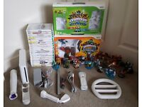 NINTENDO WII CONSOLE WITH 21 GAMES, LOADS OF SKYLANDERS AND ALL LEADS. CAN BE SEEN WORKING.