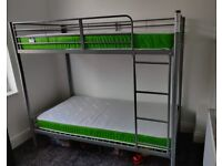 Brand new bunk beds and 2 new mattresses
