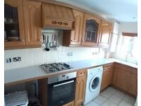 Complete solid oak wood kitchen units, cooker hood and white laminate worktops for sale  Exeter, Devon
