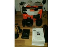 Sony SLT-A58 DLSR camera with 18-55mm lens.