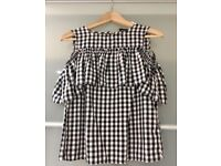 Black and white check blouse