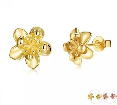 - Delightful yellow gold plated butter cup flower stud earrings