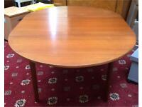 Lovely extendable wooden dining table