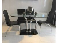 Smoked glass dining table and 4 chairs