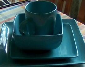 Set of turquoise square plates, bowls, mugs. Fifteen items in total.