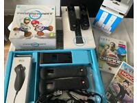 Nintendo wii with 2 games plus mario kart boxes game.