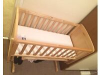 Baby Crib with rocking feature - VGC
