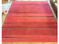 Lovely large red rug, approximate size 170 x 240cm.