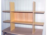 Bookcases, wall-mountable in yellow or blue.