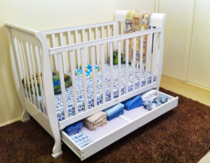 Sleigh style cot with drawer and mattress