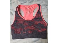 Grey and pale pink sports bra