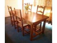 Wooden dining table and 4 chairs, used